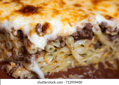 Pastitsio Traditional Greek Baked Pasta Casserole With Ground Beef, Tomatoes, Feta Cheese and Bechamel Sauce