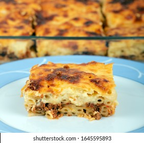 Pastitsio, traditional Greek food, with Ground Beef, baked pasta and Bechamel Sauce, cooked in casserole pan.
