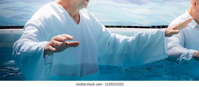 Pastor baptize man in the name of Christ