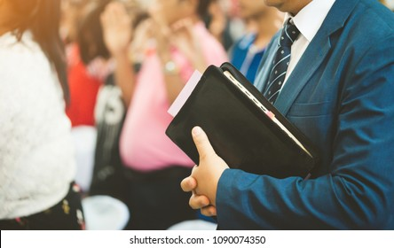 Pastor holding a bible ready for preach in church.Christian, Preacher and sunday worship concept.