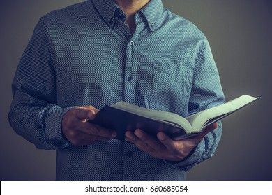 Pastor or preacher with the Bible on his hands.