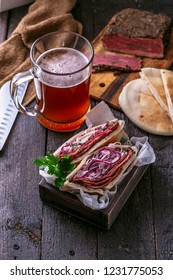 Pastrami with cabbage in pita bread with beer, rustic.