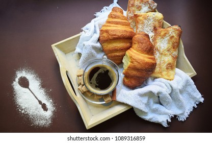 pastries and coffee on wooden tray