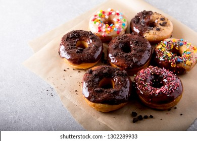 Pastries concept. Donuts with chocolate glaze and chocolate cookies/