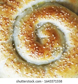 pastries with sesame seeds. Spinach and Puff Pastry Cheese Snail