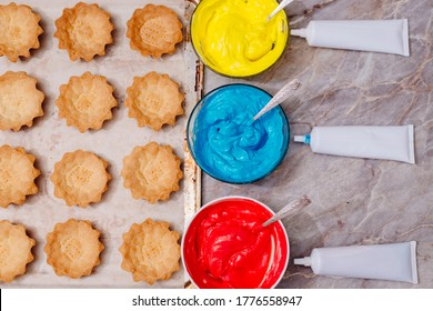 Pastry bags with colored cream inside. Food colorings. The process of making cream colored cream for tart tarts. Cream staining with food coloring. Tubes with dyes.