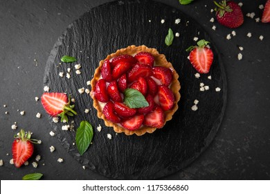 Pastry berry tart. Delicate crispy, crumbly dessert with strawberries and mint. Assorted Confectionery Range.