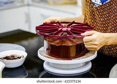 pastry chef making chocolate cake in bakery shop