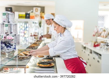Pastry chefs working in a bar cafeteria