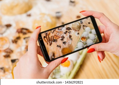 Pastry cooking vlog. Lady using smartphone to record steps of cooking gingerbread biscuits. Ingredients on screen.