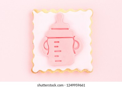 pastry with pink feeding bottle, newborn girl concept
