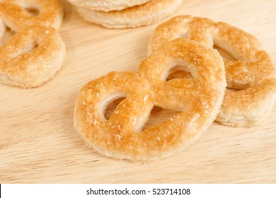 Pastry pretzel, Pretzel shaped sugar cookies made of puff pastry with butter. Soft focus