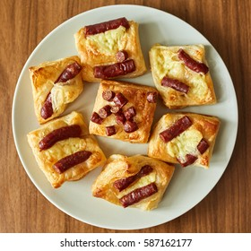 Pastry with small sausages and cheese, homemade