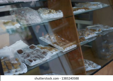 Pastry vitrine display from a bakery shop.