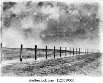 Pasture fence on meadow hill, textured in an artistic way in black and white tones with grungy sky on sandstone canvas.
