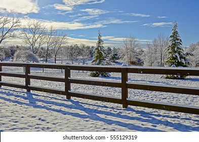 A pasture and fences in the first snow of the season.
