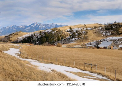 Pasture land and barn at Bozeman Pass on Old Boseman Hill Road Montana with Mount Delano of Absaroka Range