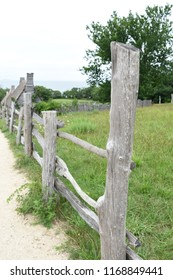 Pasture with a lovely rustic wooden fence.