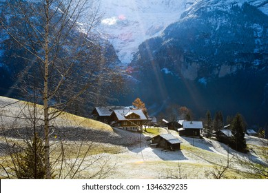 Pasture with thin snow and houses in autumn morning, Grindelwald, Berner Oberland, Canton of Bern, Switzerland