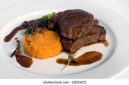 Pasture-fed Sirloin Steak, with Sweet Potato Mash, Pea Puree, and a Red Wine Jus