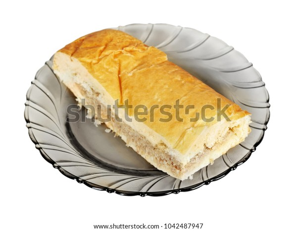 Pasty with meat on plate isolated