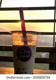 Pasuruan, East Java, Indonesia -  July 31th 2021. Feel The Sweet of Chatime beverage in sunset.