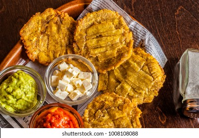 Patacones or tostonesare fried greenplantainslices, made with green plantains. Typical food from Mexico and South America.