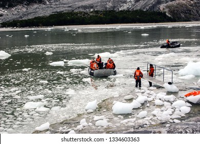 PATAGONIA, CHILE-NOV. 12, 2012:  Tourists experience a wet landing near one of Chile's magnificent glaciers of southern Patagonia.