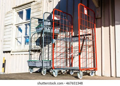 Pataholm, Sweden - August 9, 2016: Two empty metal delivery carts outside the back of a rural store.