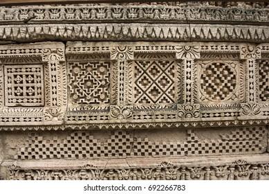 Patan / India 1 August 2017  Intricate patterns on the walls of Rani ki Vav reminescent of Patola textile designs at Patan  Gujarat  India
