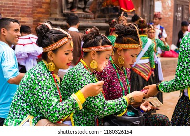 Patan, Lalitpur, Nepal - July 17, 2018 : Group of dancers wearing traditional costumes in Patan Durbar Square, UNESCO World Heritage Site, famous for cultural heritage and tradition of arts and crafts