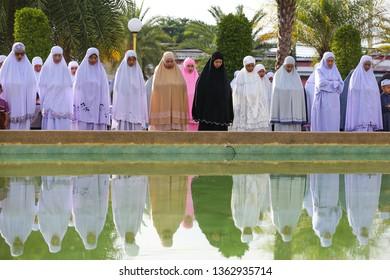 Patani/Thailand-August 22,2018: Muslim women make Qurbani Eid prayer.