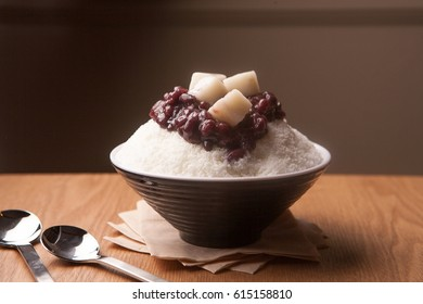 patbingsu shaved ice with sweetened red beans and syrup on bowl