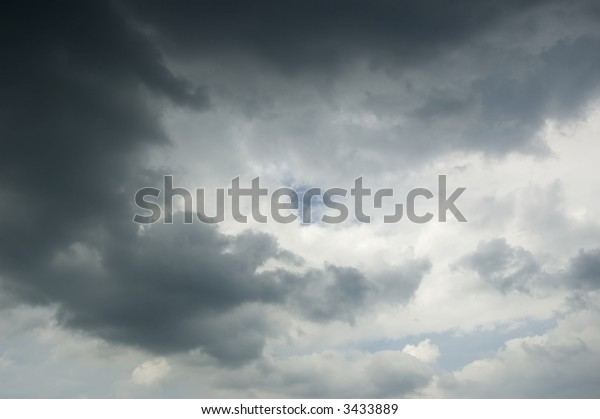 Patch of blue sky at heart of rain clouds