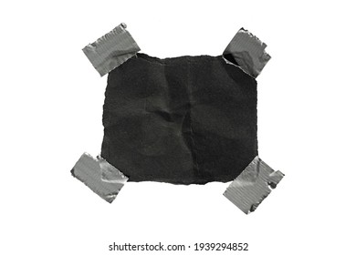 A patch in the form of a piece of black paper glued with tape.