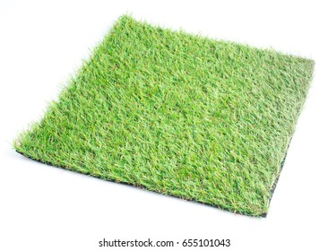 Patch of green artificial grass on a white background