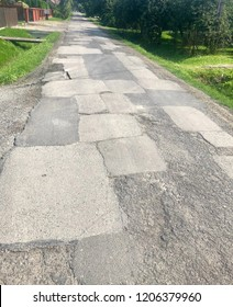Patched road surface after multiple surface repairs.