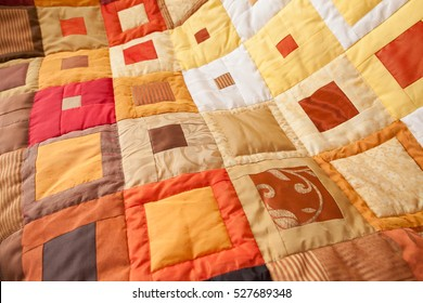 Patchwork quilt. Part of patchwork quilt as background. Handmade. Colorful blanket.