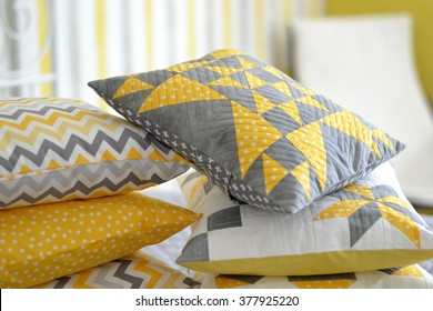 Patchwork/quilt pillows in gray, yellow and white