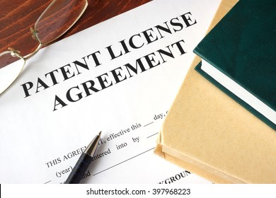 Patent License agreement on a table. Copyright concept.
