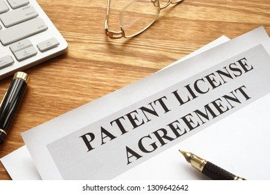 Patent license agreement with pen and glasses.