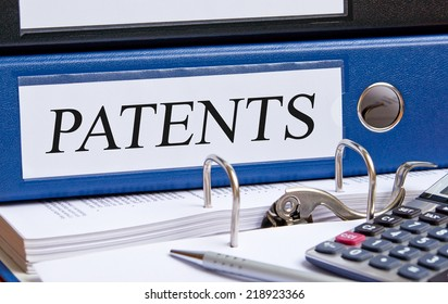 Patents - blue binder on desk in the office