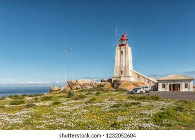 PATERNOSTER, SOUTH AFRICA, AUGUST 21, 2018: The Cape Columbine Lighthouse in the Cape Columbine Nature Reserve near Paternoster. Wild flowers and vehicles are visible