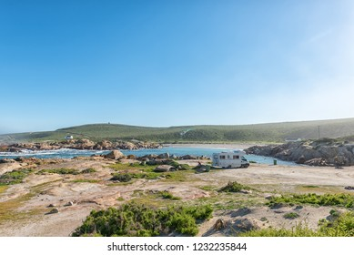 PATERNOSTER, SOUTH AFRICA, AUGUST 21, 2018: A view of Tietiesbaai Caravan Park in the Cape Columbine Nature Reserve near Paternoster. Ablution buildings and a motorhome are visible