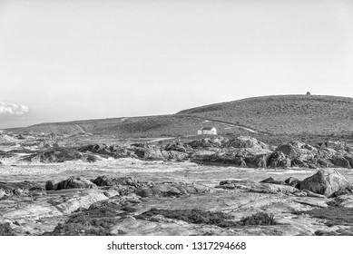 PATERNOSTER, SOUTH AFRICA, AUGUST 21, 2018: A view of Tietiesbaai Caravan Park in the Cape Columbine Nature Reserve near Paternoster. An ablution building is visible. Monochrome