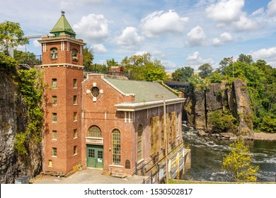 Paterson, NJ / USA - 08 31 2019: old factory building facades, details architecture and city street. Historical neighborhood with museums and old industrial buildings.