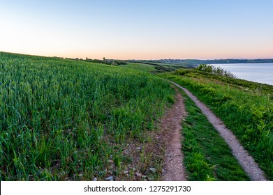 Path along the Cornish coast at dusk, Portscatho, Roseland Peninsula, Cornwall, England