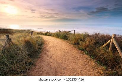 path along North sea beach at sunset, Vlissingen, Holland