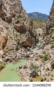Path along steep cliffs, rocks and mountain river in Spain, near Malaga