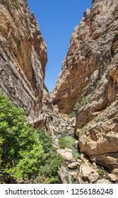 Path along steep cliffs, rocks and mountain river in Spain, near Malaga